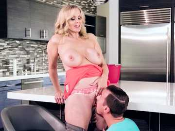Julia Ann treats her stepson to a pair of perfect MILF boobs to suck on